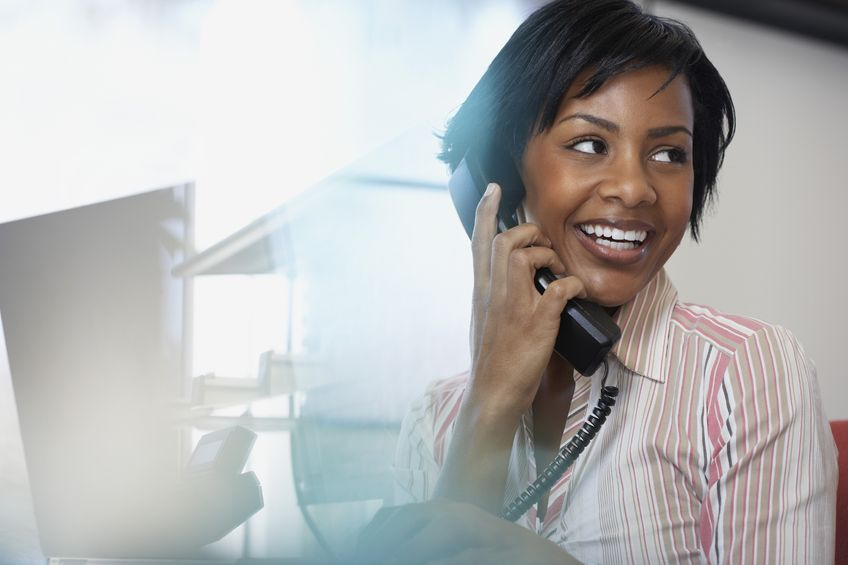 35544799 - african american businesswoman talking on telephone