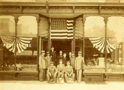 One of the many historic photographs of Queens on display at the new Executive Office Center in Fresh Meadows. This image depicts the Flushing Post Office that was located on Main Street in 1898. Courtesy Queens Historical Society